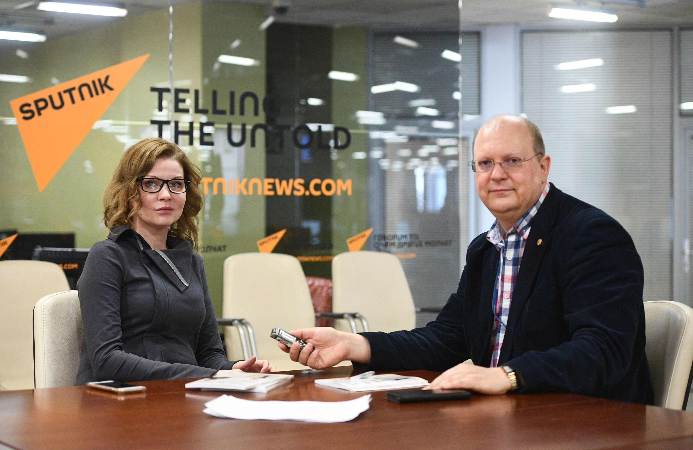 Koordynator stowarzyszenia KURSK w Rosji Anna Zacharian i komentator Agencji Sputnik Leonid Swiridow