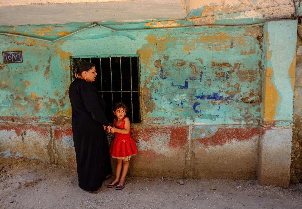 Koptyjska kobieta z dzieckiem w Migne