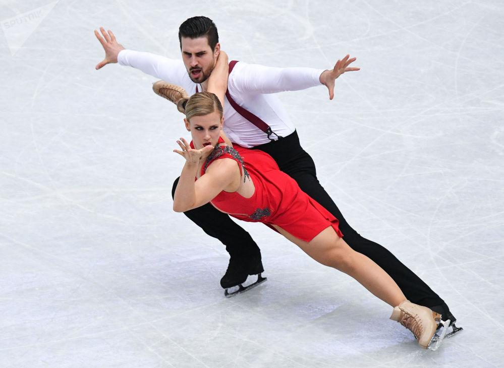 Amerykańscy łyżwiarze figurowi Madison Hubbell i Zachary Donohue wykonują rytmiczny taniec na Mistrzostwach Świata w łyżwiarstwie figurowym w Saitame.