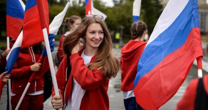 Uczestnicy święta Dzień flagi rosyjskiej w Nowosybirsku