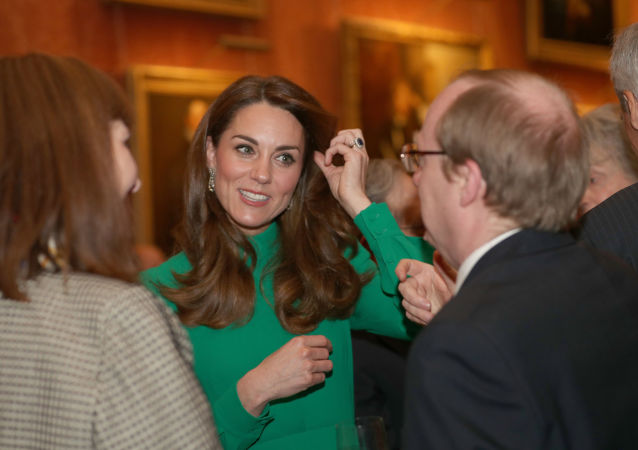 Księżna Cambridge Katarzyna na przyjęciu w Pałacu w Buckingham w Londynie