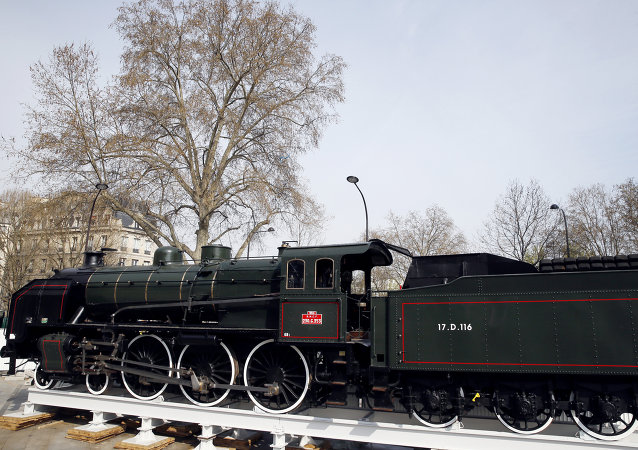 A picture taken on March 28, 2014 in Paris shows the locomotive of the legendary train the Orient Express, which is displayed in front of the Arabic World Institute for the exhibition Once upon in time the Orient Express