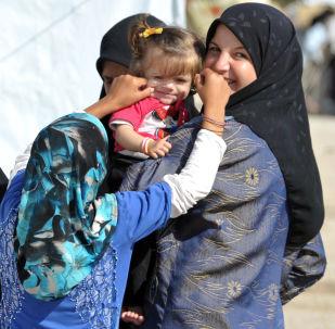 Uchodźcy z obozu w Latakii