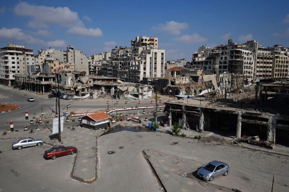 Zniszczone budynki w mieście Hims w Syrii