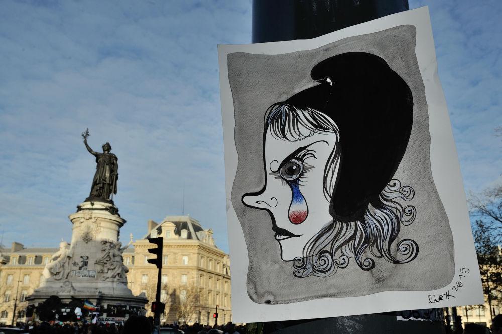 Graffiti przedstawiające symbol kultury oraz narodowy emblemat Republiki Francuskiej