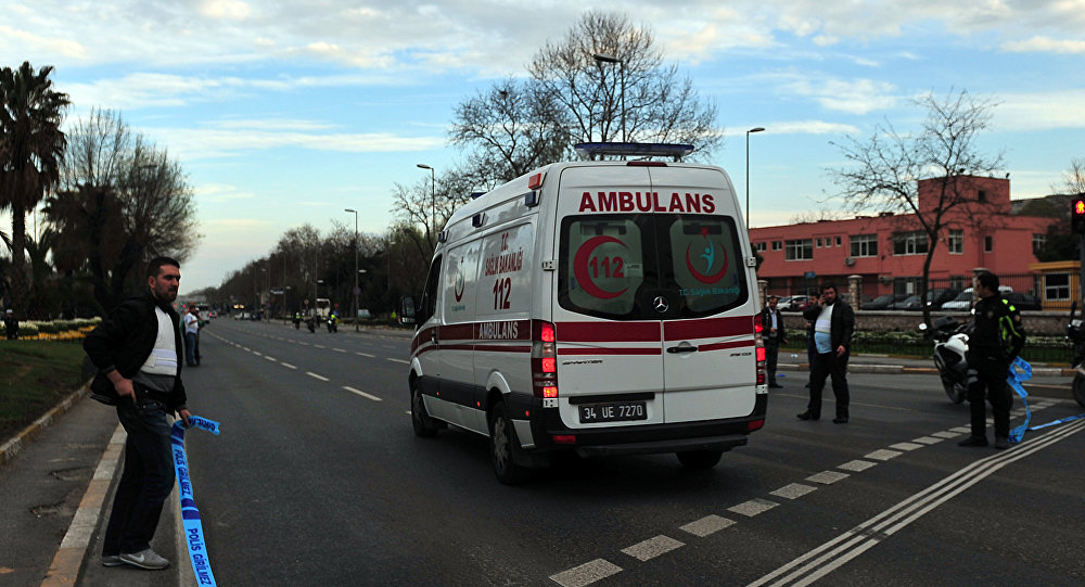 An ambulance drives to Istanbul Police department headquarters , on April 1, 2015 in Istanbul