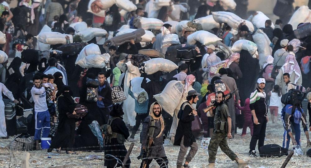 Syryjscy uchodźcy na syryjsko-tureckiej granicy