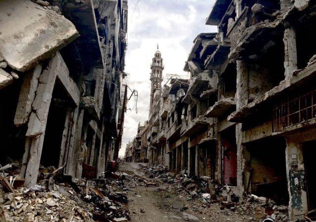 Zniszczenia w mieście Homs w Syrii