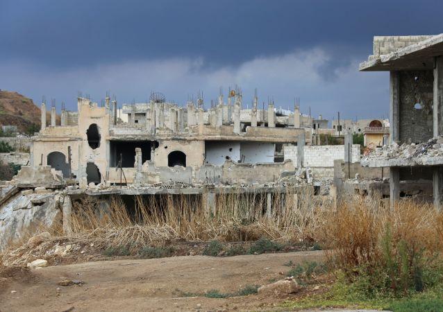 Zniszczony dom w syryjskiej prowincji Hama