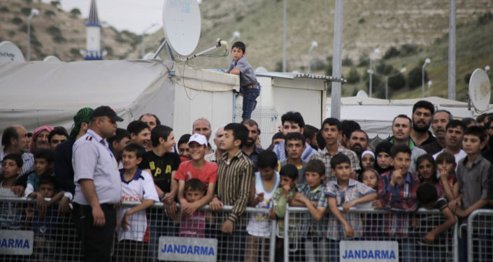 Uchodźcy w obozie na granicy turecko-syryjskiej