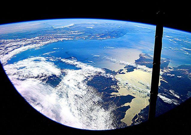 Ziemia sfotografowana przez kosmonautę Jurija Malenczenko