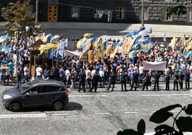 Protesty górników przed siedzibą ukraińskiego rządu w Kijowie