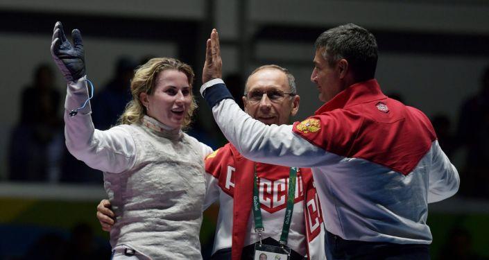 Inna Derigłazowa, Ildar Mawliutow, Ilder Mamiedow podczas Olimpiady 2016