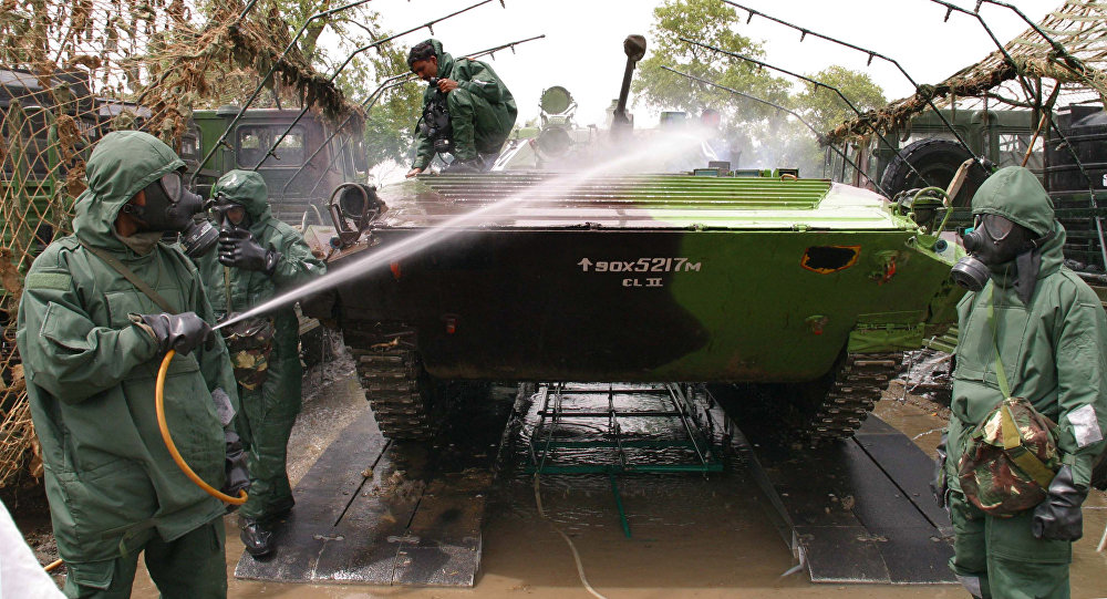 Indian Army soldiers wear protective suits and wash a tank as they perform a chemical weapon decontamination exercise, during a military exercise in Jagraon, in the northern Indian state of Punjab (File)