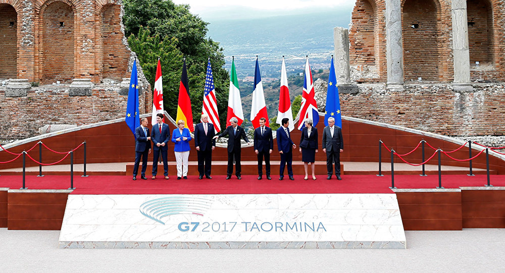 From L-R, European Council President Donald Tusk, Canadian Prime Minister Justin Trudeau, German Chancellor Angela Merkel, U.S. President Donald Trump, Italian Prime Minister Paolo Gentiloni, French President Emmanuel Macron, Japanese Prime Minister Shinzo Abe, Britain's Prime Minister Theresa May and European Commission President Jean-Claude Juncker pose for a family photo during the G7 Summit in Taormina, Sicily, Italy, May 26, 2017.