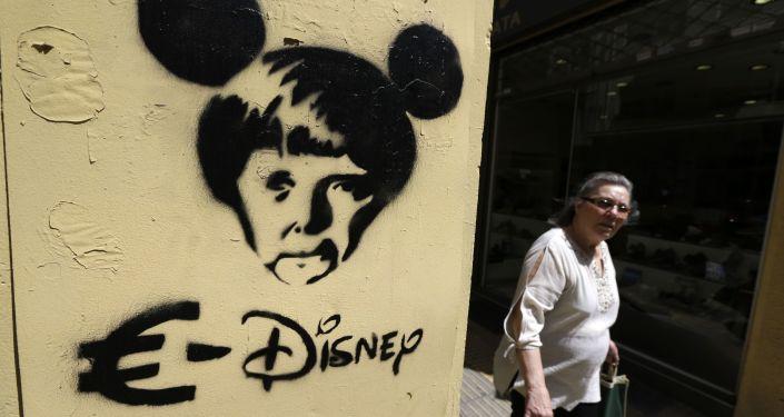 Graffitti przedstawiające kanclera Niemiec Angelę Merkel w Atenach