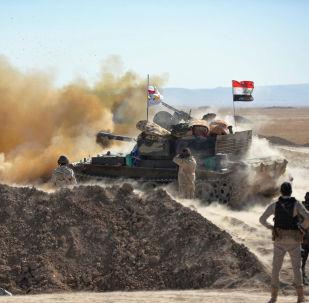 Bojownicy Sił Narodowej Mobilizacji Iraku podczas szturmu na Tall Afar