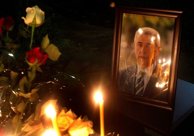 Portret serbskiego polityka Olivera Ivanovicia na miejscu zabójstwa