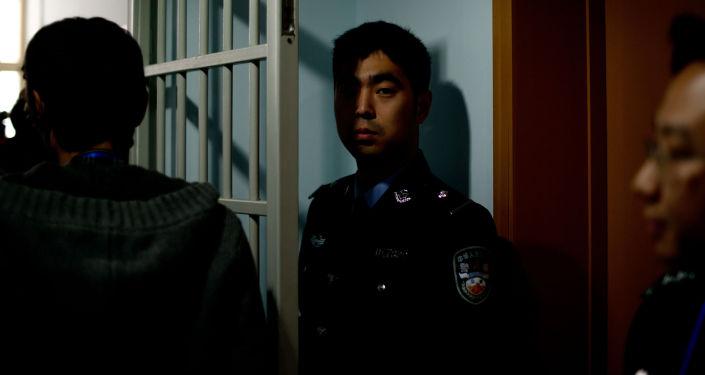 Ochroniarze w centrum dla więźniów w Pekinie