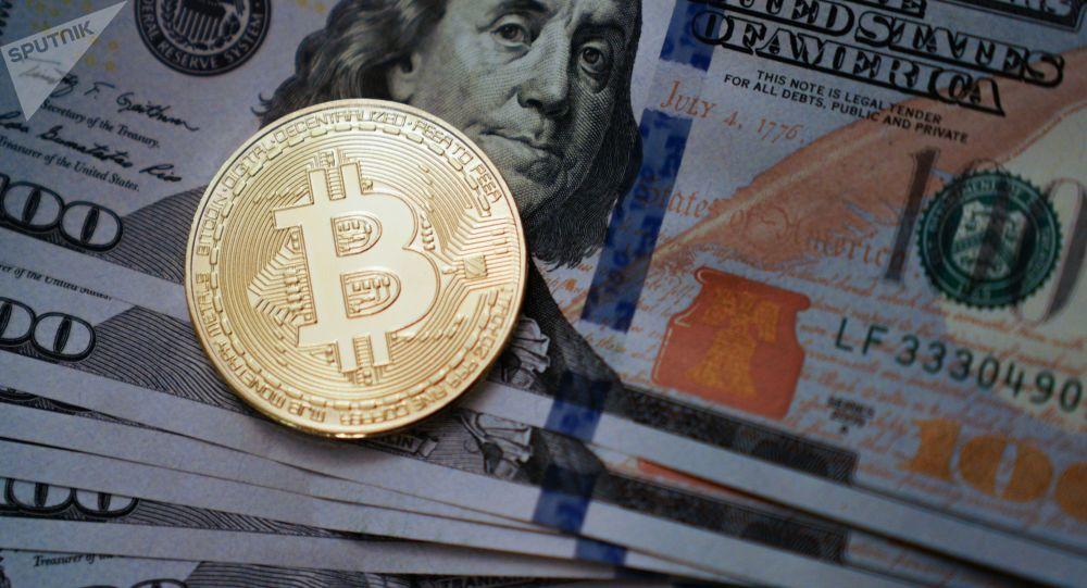 Moneta pamiątkowa z logotypem bitcoina