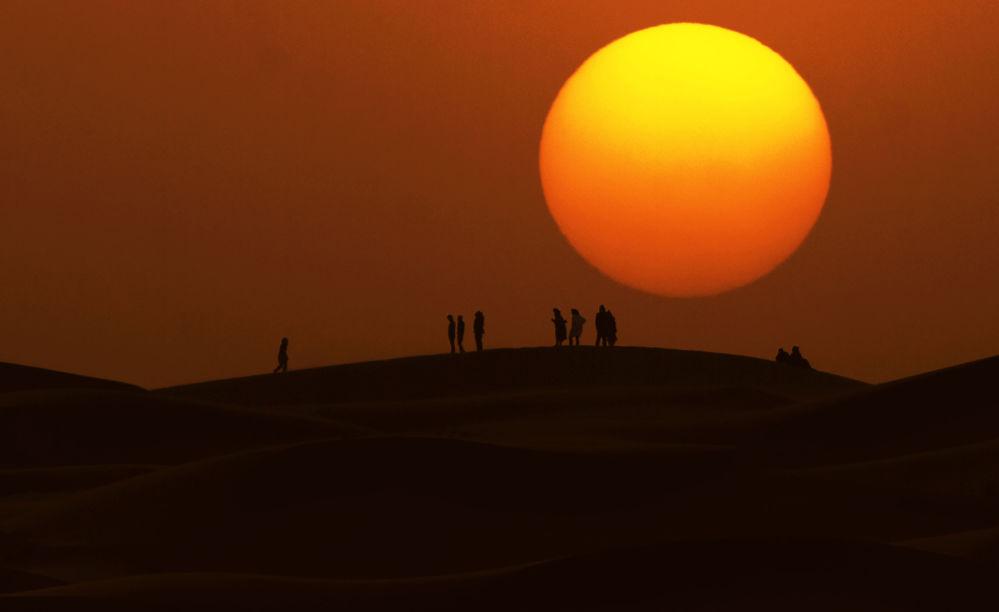 Zachód słońca na Saharze