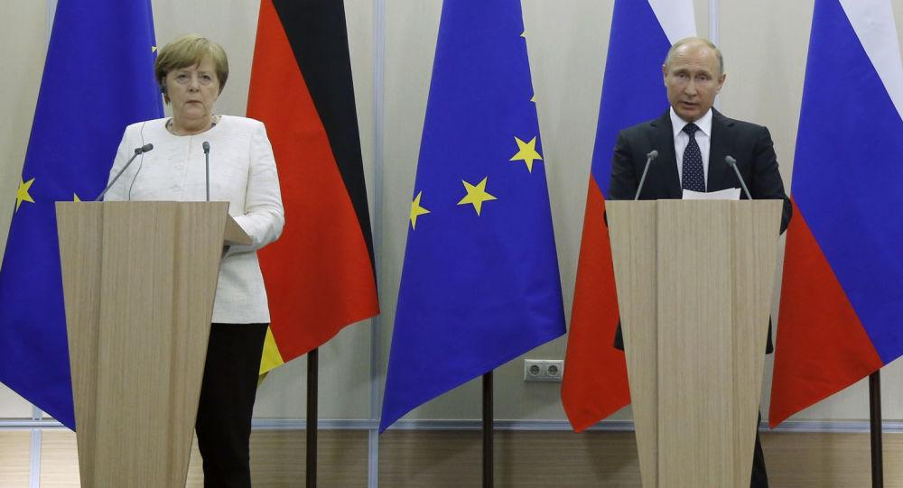 Władimir Putin i Angela Merkel