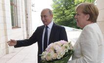 Prezydent Rosji Władimir Putin i kanclerz Niemiec Angela Merkel w czasie spotkania w Soczi