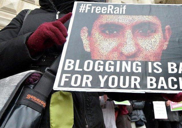 Protest przeciwko więzieniu saudyjskiego blogera Raifa Badawi