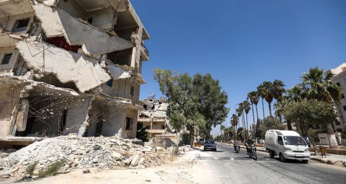 Zniszczone budynki w mieście Idlib, Syria