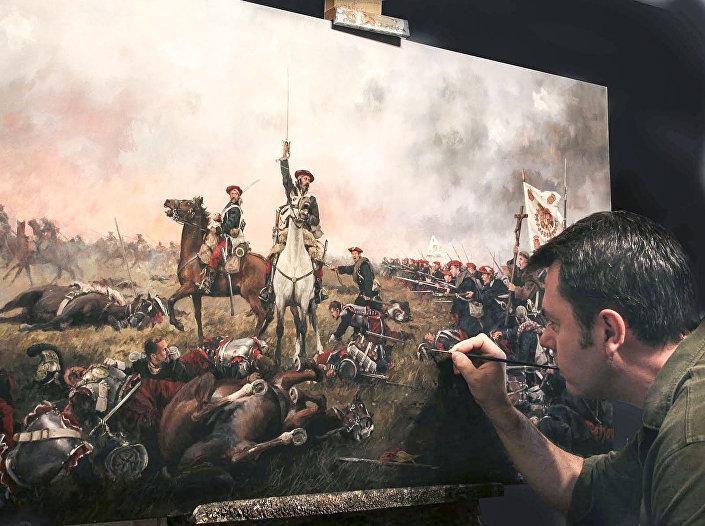 Hiszpański artysta Augusto Ferrer-Dalmau Nieto podczas malowania obrazu