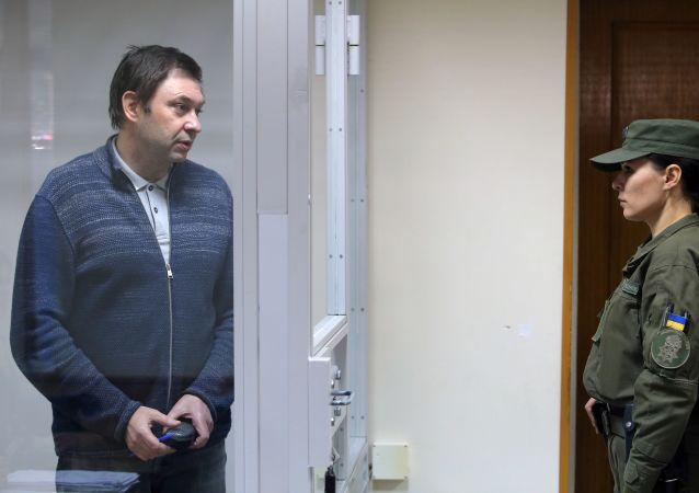 Kierownik RIA Novosti Ukraina na posiedzeniu sądu w Chersoniu, Ukraina